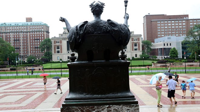 Alma Mater, the bronze statue of the goddess Athena on Columbia's campus, seen from behind.