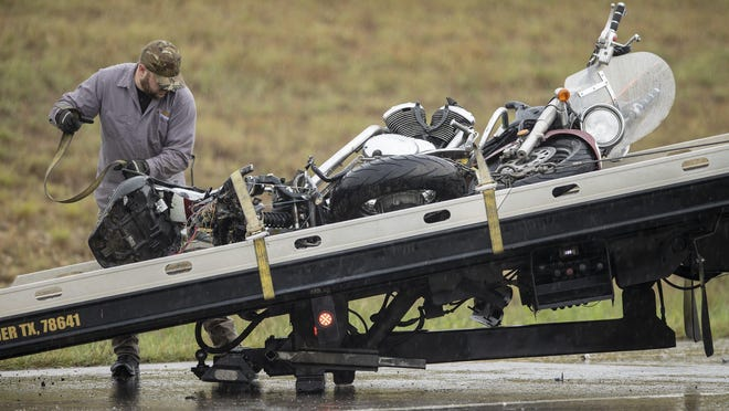 A tow truck driver loads a motorcycle that was struck by a car in fatal hit-and-run collision at the intersection of 183A and Bryson Ridge Trail in Leander on Wednesday.