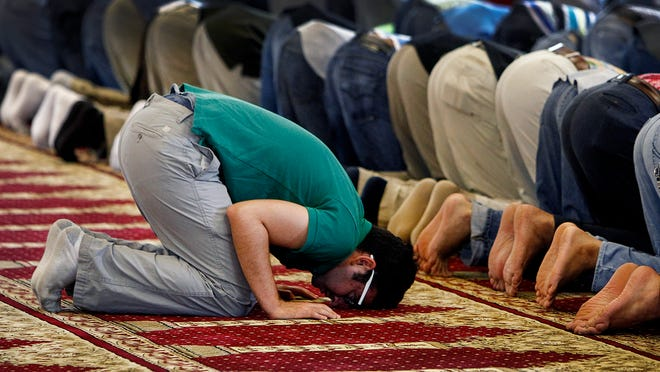 Khaled Mhaissen takes part in a pray service at Masjid Ar-Rahman mosque in Memphis, Tenn. Friday, June 27, 2014. Saturday is the first day of the holy month of Ramadan, celebrated by Muslims around the world.