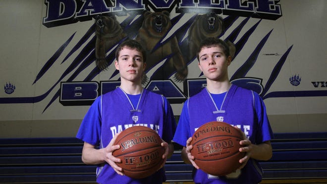 Danville High School basketball players Steven and Michael Soukup are pictured in 2012 in the school's gymnasium. The two will be co-head boys basketball coaches next season at Danville.