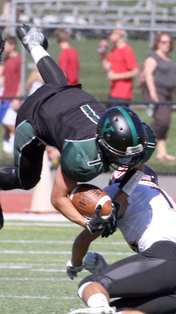 Yorktown's Brandon Meyreles is upended by Rye's Kyle