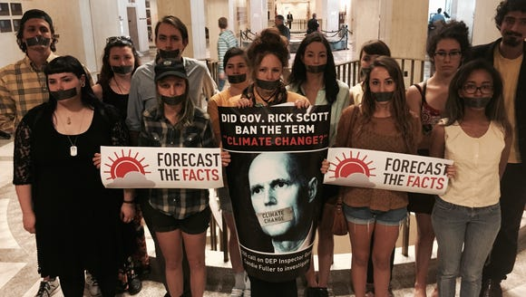 Students wear duct tape across their mouths to protest