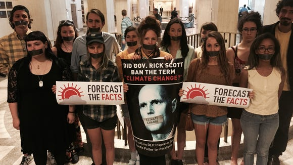 "Students wear duct tape across their mouths to protest  so-called state-agency gag order on ""climate change"" talk."