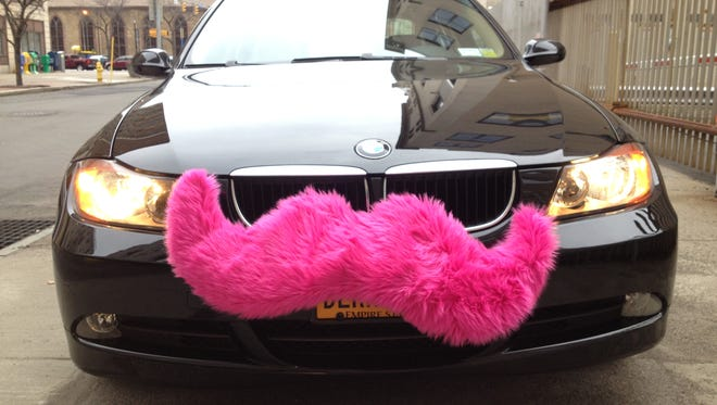 A large mustache mounted to a vehicle?s grill is the hallmark of a Lyft driver.