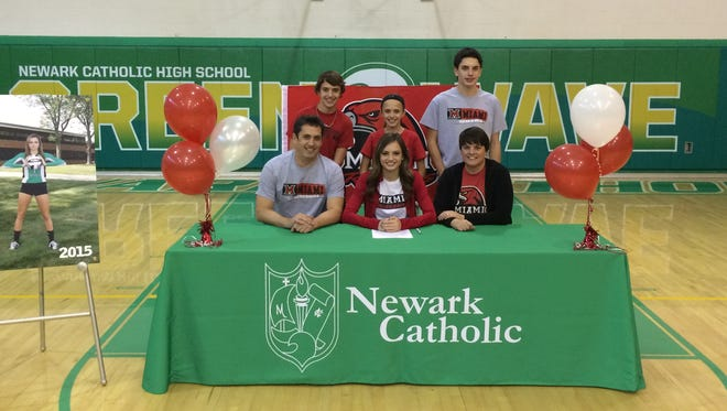 Taylor Daignault signed her letter of intent Wednesday to play volleyball at Miami University.
