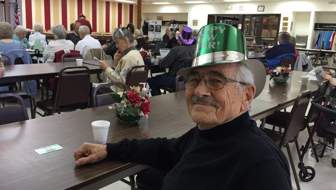 Rudy Roman, of Binghamton, wears his festive hat proudly Thursday during the New Year's luncheon at the Johnson City Senior Center.