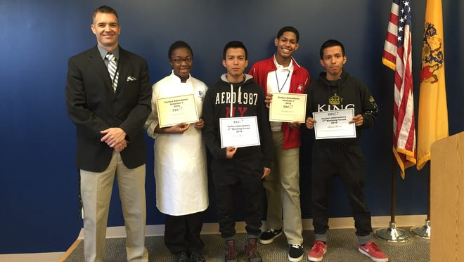 (From left) Cumberland County Technical Education Center Principal Greg McGraw and students Daija Livingston, culinary arts; Cesar Rivera, automotive technology; Christopher Abreu, law enforcement; and Alberto Rivera, law enforcement, celebrate perfect attendance.
