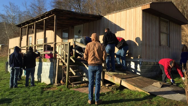 """Youth Go participants in 2015 were involved in the construction of a wheelchair ramp at a home in Rockcastle County, Kentucky. Members will return to Kentucky next week for its 10th annual spring break service trip."""""""