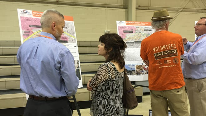 Consultants speak with residents at an open house April 27 in Lafayette, Louisiana on the proposed I-49 connector.