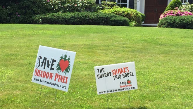 Some neighbors who live near Shadow Pines Golf Club on Whalen Road in Penfield have posted signs in support of it.