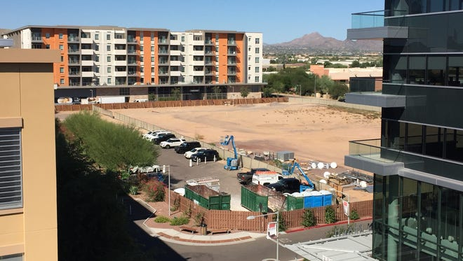 Scottsdale Quarter could soon grow larger with plans for an eight-story tower with shops, restaurants and apartments on the last vacant dirt lot within the shopping complex.