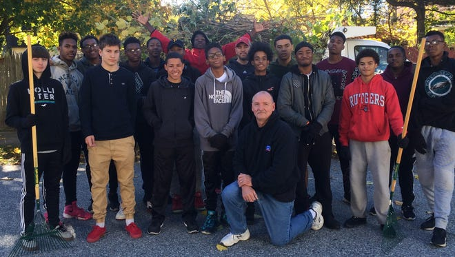 Millville High School's basketball team partnered with Mike McNiss and the Clean Communities Program for the city of Millville for a cleanup on Nov. 5.