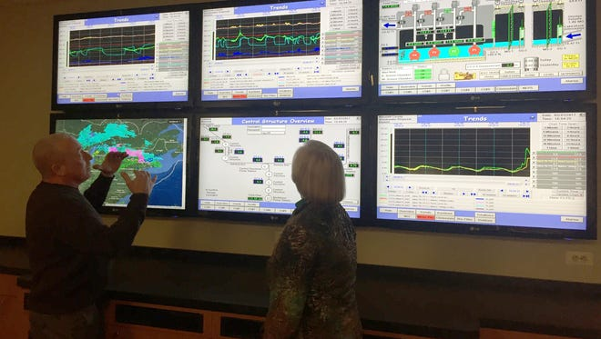 Joe Betz, supervisory and control data acquisition manager, left, and Macomb County Public Works Commissioner Candice Miller watch the weather and sewer flows at public works' command center in Mt. Clemens on Feb. 7, 2017.