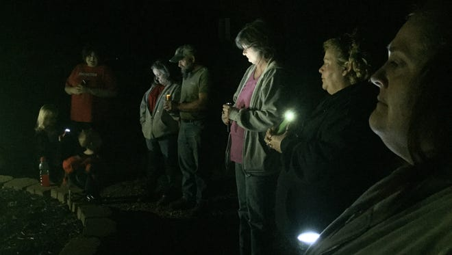 Family and friends of Curtis Henke hold a vigil Friday to pray for the man, who ran from the Volunteers of America. Henke battles a heroin addiction.