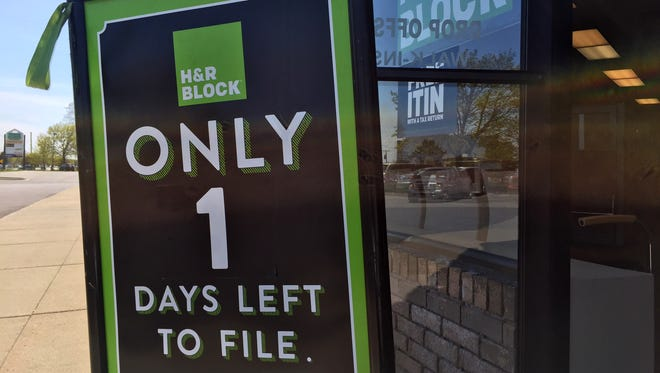 A sign outside the H&R Block office on Gratiot Avenue in Clinton Township reminds folks they one have today to file their tax returns.