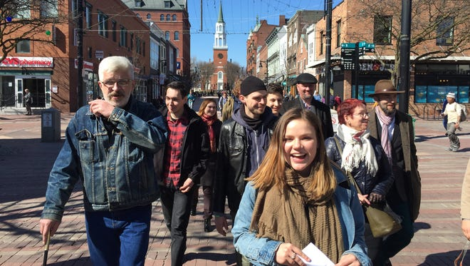 University of Vermont student Liza Shkurina leads a tour of Russians down the Church Street Marketplace on Tuesday.