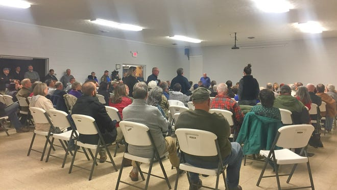Riceville residents packed the meeting room of their fire department Thursday night for a meeting held at the request of Buncombe County officials.