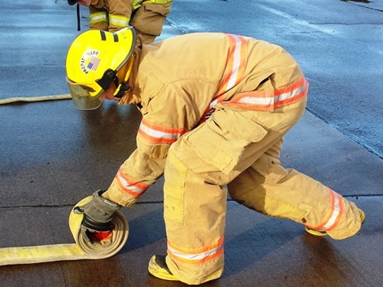 The basic: recruits learn how to roll hose.