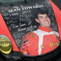 A memorial paint-scheme for driver Sean Edwards is seen on the hood of a NGT Porsche 911 GT3 Cup before the American Le Mans Series' Petit Le Mans auto race at Road Atlanta in 2013.