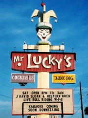 The sign for Mr. Lucky's is shown in 2007.