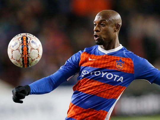 FC Cincinnati defender Justin Hoyte (32) crosses the