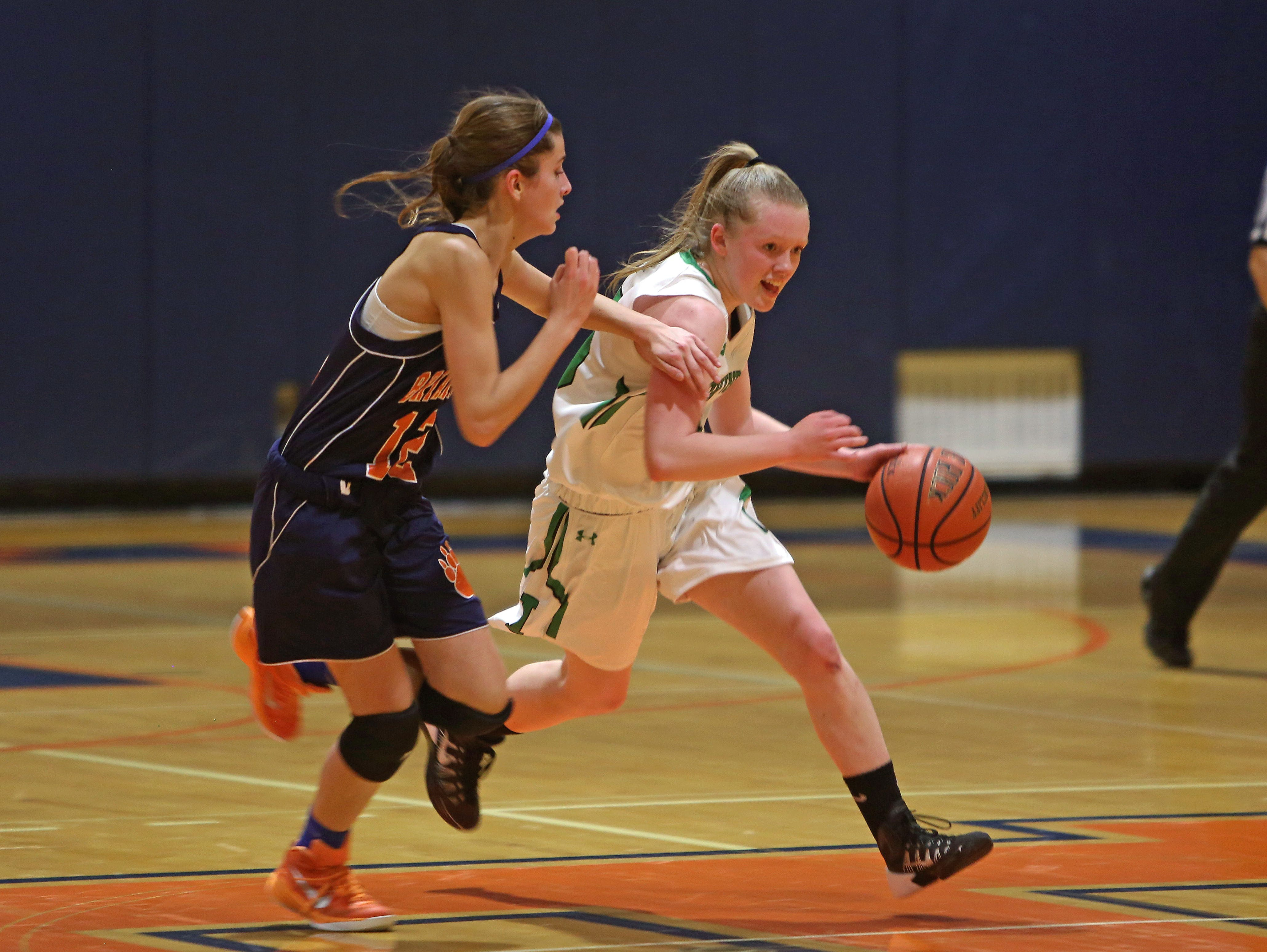 Irvington's Lindsay Halpin (15) drives by Briarcliff's Alana Lombardi (12) during girls basketball action at Briarcliff High School Dec. 1, 2015. Irvington won the game 71-57.