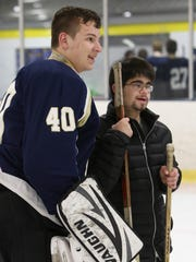 "Salesianum goalie Bobby Cathell poses for a snapshot with ""buddy"" Donnie Schwartz, 16, as the four high school hockey teams in the DFRC Hockey for a Cause doubleheader and their buddies spend ice time together at the University of Delaware's Gold Ice Arena Wednesday."