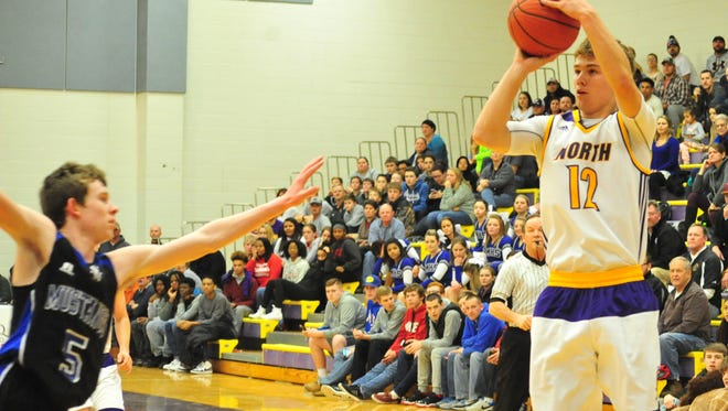 Kyle Decker (12) and the North Henderson boys are a state-ranked team in NCHSAA 3-A basketball.