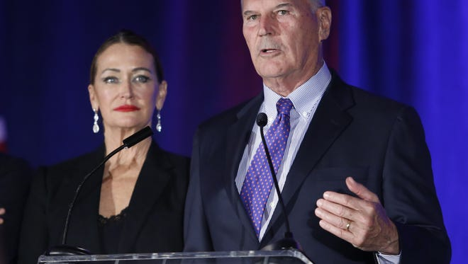 Wilmington mayor-elect Mike Purzycki delivers a victory speech at the Democratic gathering flanked by his wife, Bette, at the DoubleTree Hotel in Wilmington Tuesday.