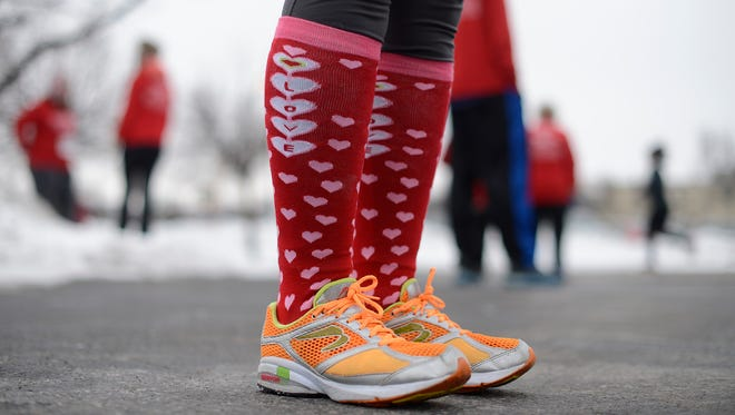 "Angela Anderson, from Allouez, wears a pair of ""Love"" socks to the 10th annual Seroogy's Valentine Run/Walk in De Pere on Saturday."