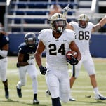 Sep 13, 2014: Pittsburgh Panthers running back James Conner (24) runs for a touchdown in fourth quarter in a game against the FIU Golden Panthers at FIU Stadium. Pitt won 42-25.