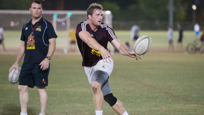 Arizona State rugby player Chris Coyle practices with the team on the intramural fields in Tempe on March 31, 2015.