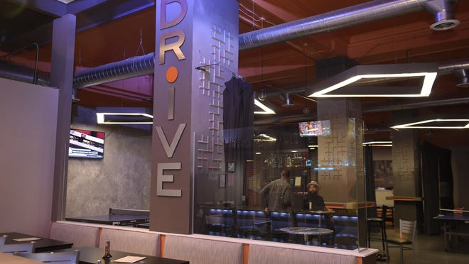 At Drive, a table tennis social club, die-hard and casual ping pong players can mingle. Childhood friends renovated the space in the Penobscot Building and offer private suites for players, along with a large bar, food menu and craft beers.