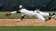 Delbarton shortstop Andrew Papantonis makes a diving play on a hard ground ball during a Morris County Tournament semifinal against Mount Olive.  Bob Karp/Staff Photographer.