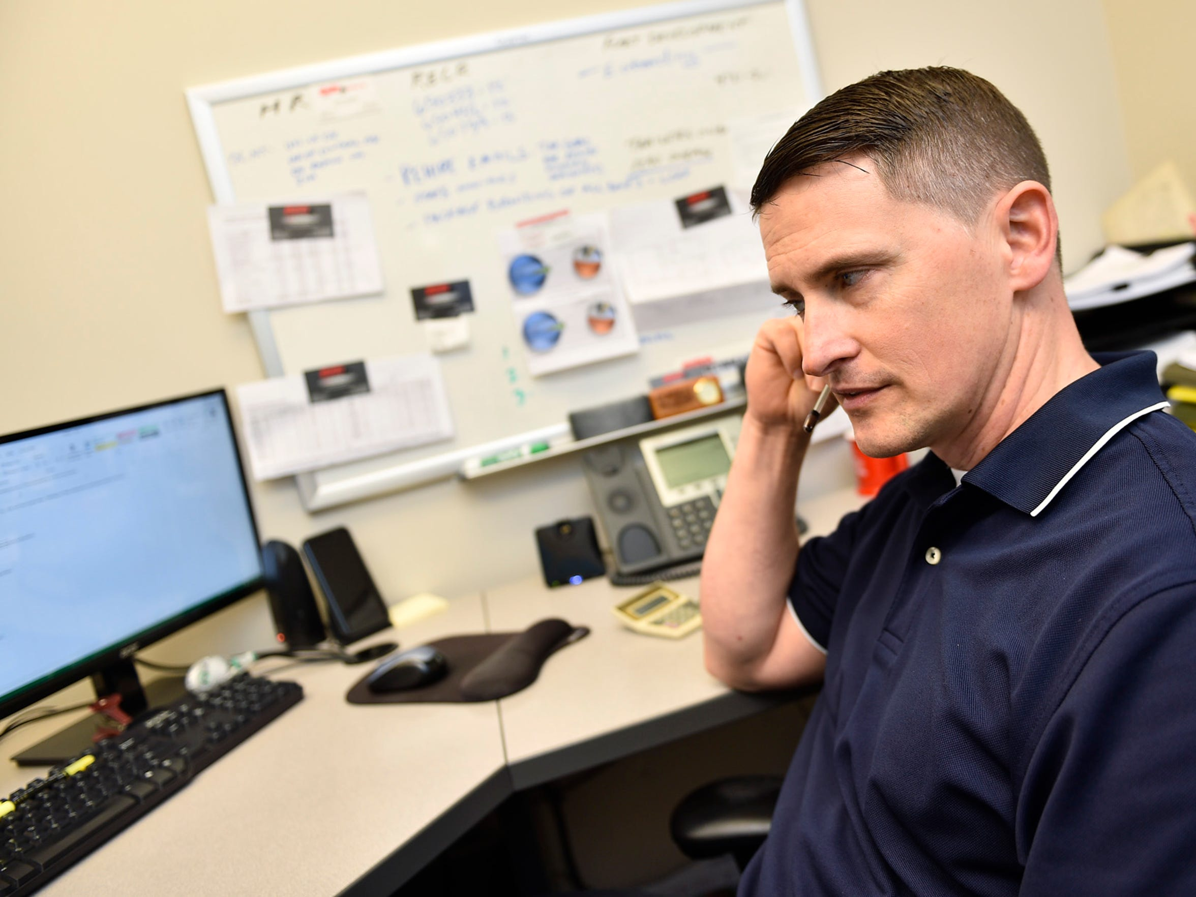 Erik Thompson, a 1994 Shippensburg University graduate, works at his desk Thursdahy, June 8, 2017. Thompson is director of fleet development and human resources at Daily Express, Inc., Carlisle.