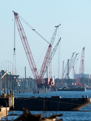 Construction on the replacement bridge over Pensacola Bay progresses on Monday, Feb. 5, 2018. The U.S. Coast Guard has established a 500-yard safety zone around the construction project that forces boaters to slow down or face fines.