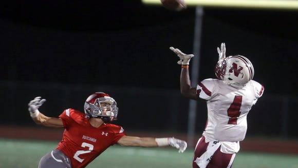 Nyack's Gee Medorzil catches a touchdown pass over