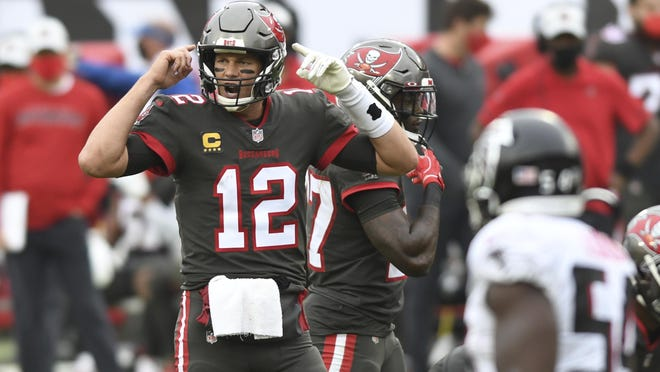 Tampa Bay Buccaneers quarterback Tom Brady (12) calls a play against the Atlanta Falcons during the second half of an NFL football game Sunday, Jan. 3, 2021, in Tampa, Fla.