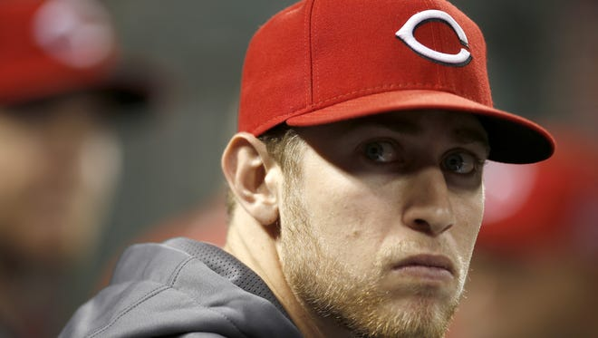 Reds pitcher Jon Moscot sits in the dugout between innings.