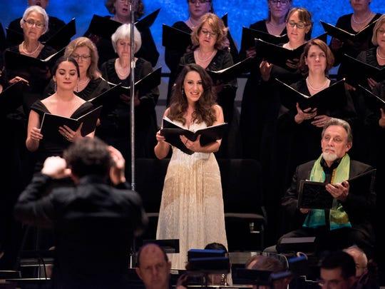 Soloists Gina Perregrino and Anya Matanovic with the women of the May Festival Chorus and Youth Chorus.