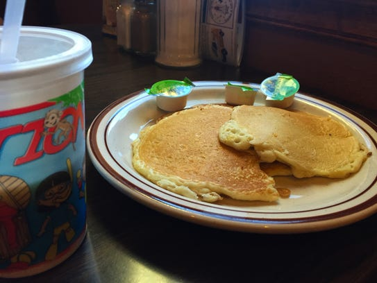 Kids order of pancakes ($2.45) and a small milk ($1.10).