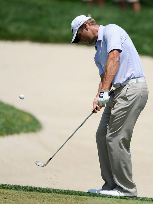 Shawn Stefani chips on the second hole during the final round of the Quicken Loans National golf tournament, Sunday, June 29, 2014, in Bethesda, Md. (AP Photo/Nick Wass)