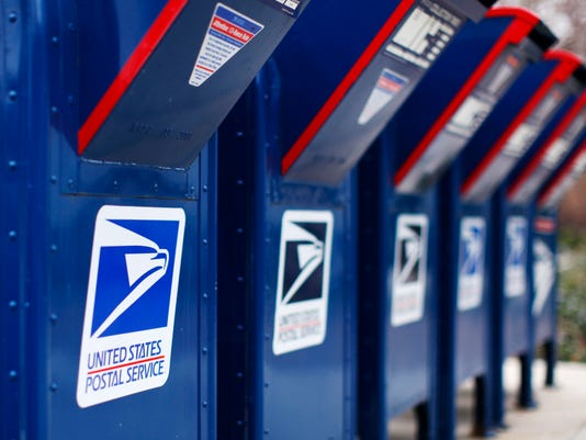 File photo of U.S. postal service mail boxes at a post office in Encinitas
