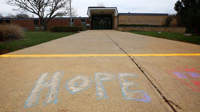 """Chalk was used to leave messages on sidewalks around Worthington, including this one pictured March 24 that leads to Worthington Estates Elementary School during the state's """"stay-at-home"""" order to help curb the spread of the COVID-19 coronavirus."""