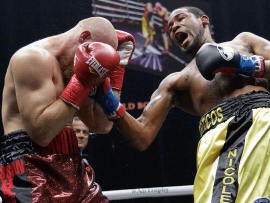 Yunier Dorticos drops Dmitry Kudryashov with a right