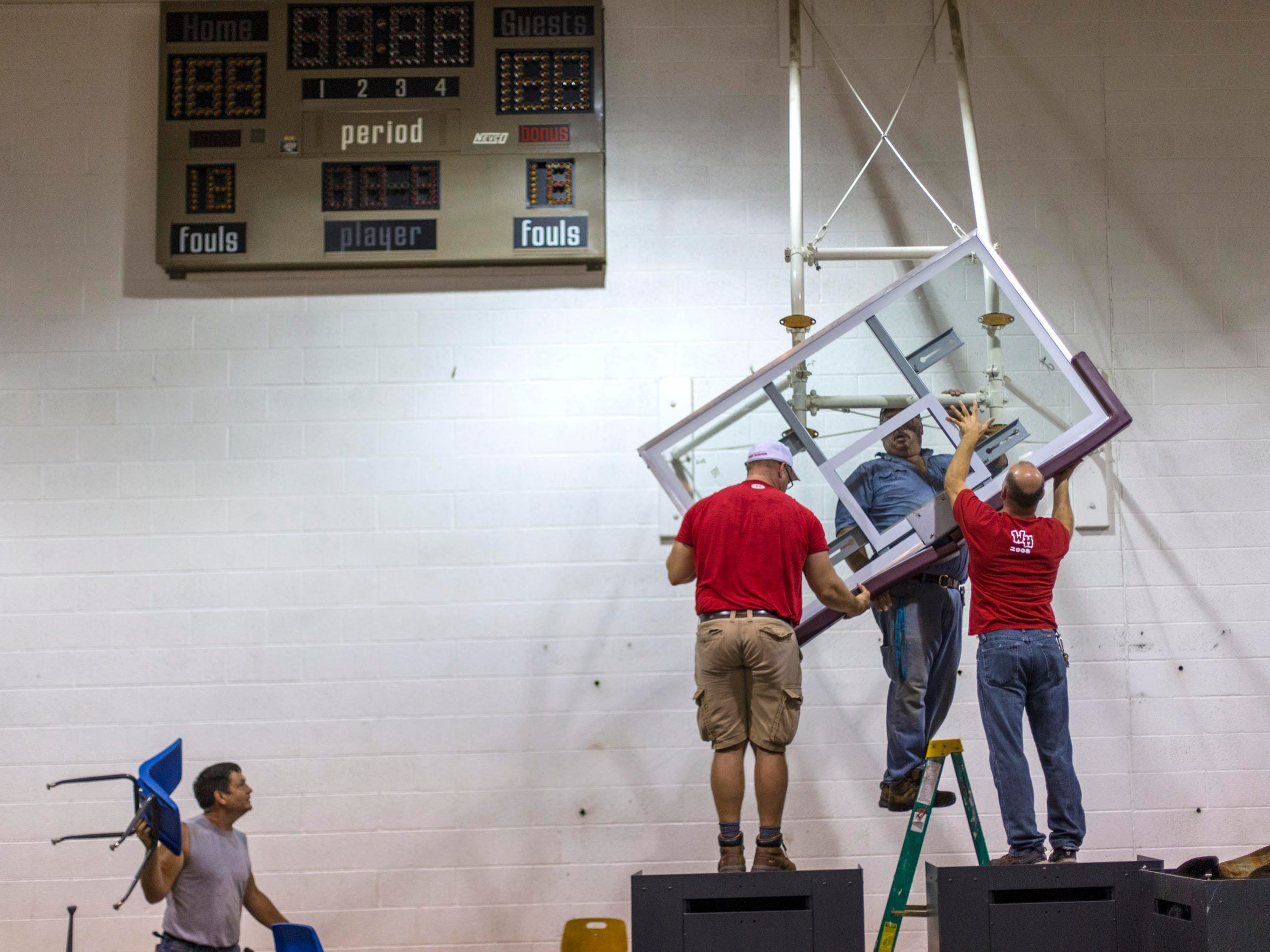 The basketball goals are removed in the gym Saturday Sept. 26, 2015, at the Corwith-Wesley High School community garage sale. Everything was for sale as the community readies the building for demolition.