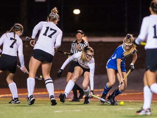 Kylie Bomgardner, Palmyra,  fights off Halle O'Neill,