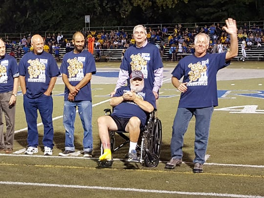 Over 40 former players and family members of deceased players and coaches were recognized at halftime of the Sept. 2. game against Castle.