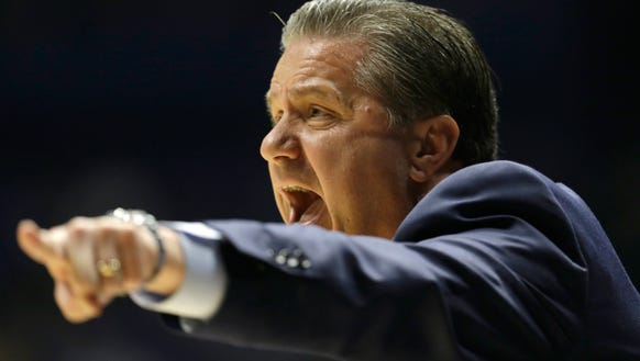 Kentucky head coach John Calipari directs his team