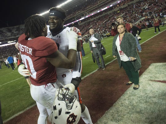 Alabama linebacker Reuben Foster (10) greats Auburn